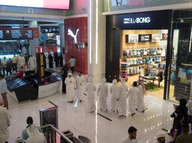 Male Emirati shoppers in Dubai Mall. Olympus 17mm f1.8